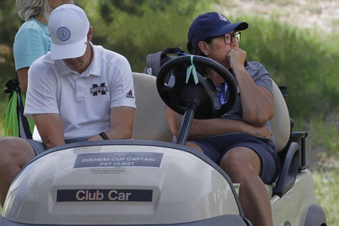 Team USA Solheim Cup Captain Pat Hurst, right,drives a golf cart during the quarter final ...