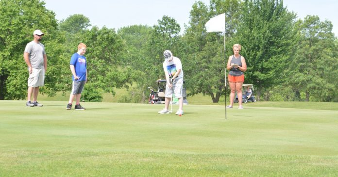 Hole in One - Newton Daily News