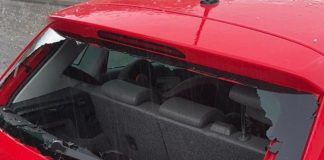 Hailstones the size of golf balls hit the driver's windshield and dent the vehicle