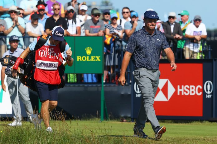 Bryson DeChambeau of the USA walks off the second tee with his caddie Brian Zeigler after playing his tee shot during Day Four of The 149th Open at Royal St George's Golf Club on July 18, 2021 in Sandwich, England.