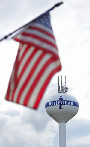 Doylestown's water tower is framed by an American flag.