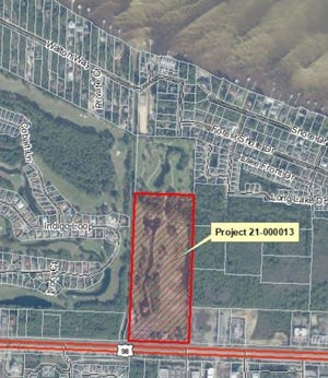 This aerial photo shows the 25 acre property in Miramar Beach proposed for mixed use development with 321 homes and commercial spaces.  The project will be examined by the local government for the first time on Wednesday.