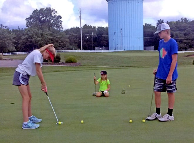 Young golfers practice their putting skills on the Green Hills Golf Course's large practice green.  From July 28th to 29th, GHGC is organizing a two-day youth golf camp.