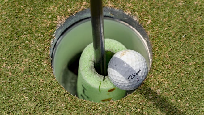 On the 18th hole, a small piece of foam noodle is placed around the flagstick so that golfers do not stick their hands in the cup and the coronavirus may be transmitted to another person on April 28, 2020 at the Abacoa Golf Club in Jupiter.