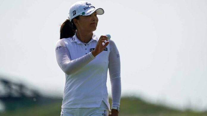 Jin Young Ko of Korea reacts to the crowd after making a putt on the second hole during the third round of the Volunteers of America Classic