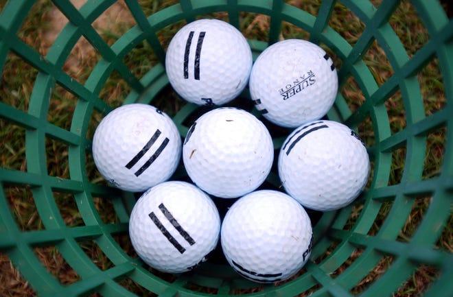 02-12-04, Tuscaloosa, Ala .., Golf balls at the Ol Colony Golf Course on Watermelon Road Thursday afternoon.  (Tuscaloosa News / Jason Getz)