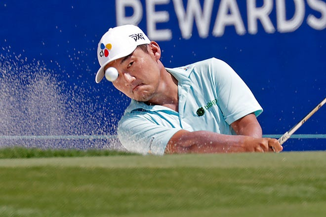 Sung Kang strikes a trap on the 18th hole during the first round of the Wyndham Championship golf tournament at Sedgefield Country Club in Greensboro, NC on Thursday, August 12, 2021.