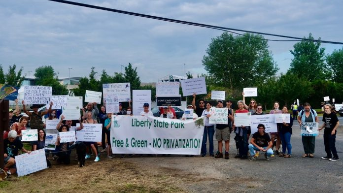 Protesters Confront Liberty National Golf Club's Fireman