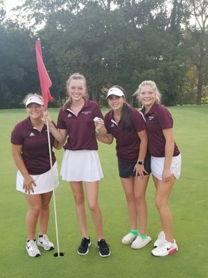 Princeville's Audrey Bowermaster, second from left, holds her golf ball after a hole-in-one on Monday.  The junior scored an ace in her second high school golf meeting ever. She is linked from left to right on the 17th green with her playing partner Kiara Cihla, Bridget Gilroy and Paisley Schock.  Team member Neleh Geiger is not shown.