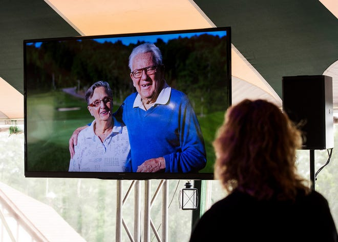 A photo of Coco and Ray Lajoie appears on a big screen at the 2018 Lori Lajoie Charity Golf Tournament at Worcester Country Club.