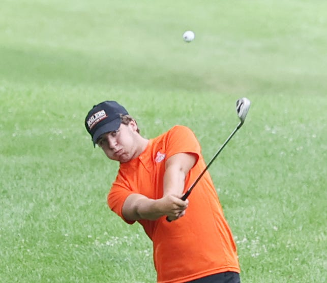 KHS's Emmitt Brokaw hits his second shot on the green during the varsity match with LaSalle-Peru on Thursday, August 12, in Baker Park.  He was the Kewanee medalist at 45.