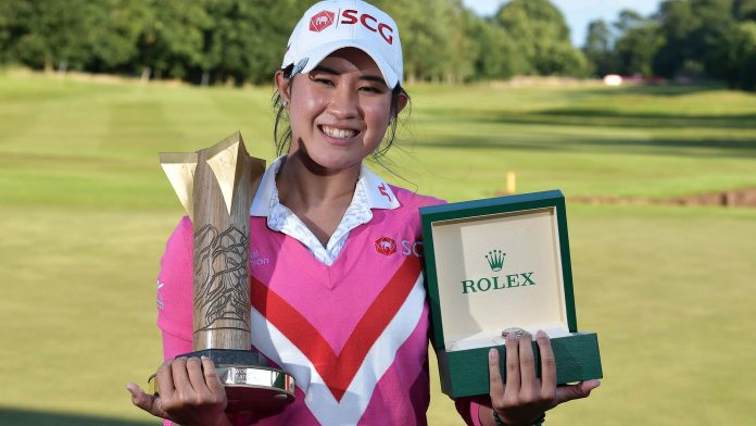 Pajaree Anannarukarn of Thailand poses with the trophy and a Rolex watch after her victory on the second playoff hole during the final round of the ISPS HANDA World Invitational