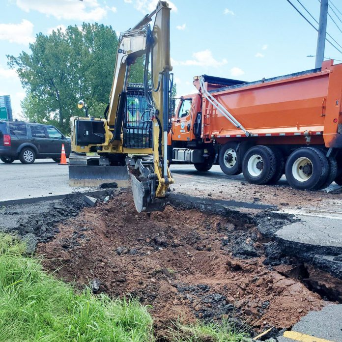 Repair work begins on a sinkhole on the PGA Tour Golf Course in Cromwell