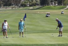Golfers play the 18th hole on the Legend Course at Tahquitz Creek Golf Resort in Palm Springs, one of two courses on the city's own facility.