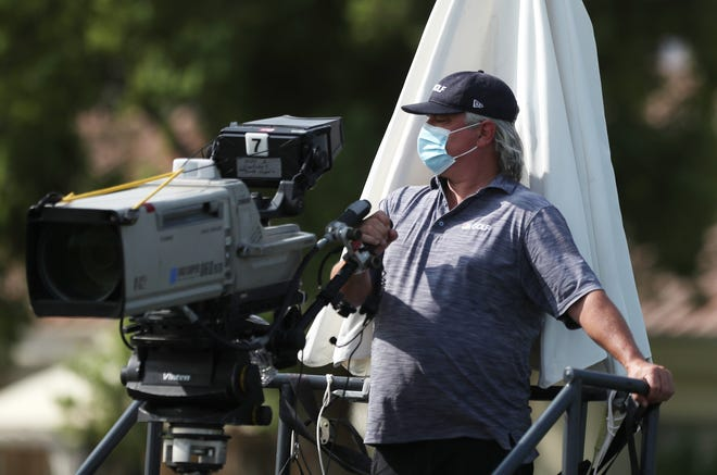 A cameraman prepares to cover the first round of ANA Inspiration at Mission Hills Country Club in Rancho, Mirage, California on September 10, 2020.