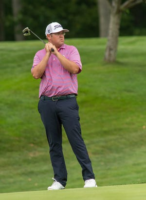 Bob Bruso watches a putt-roll on the fifth green Tuesday during the New England PGA Section Championship at the Worcester Country Club.