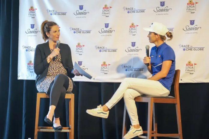 Cara Banks talks to LPGA player Mel Reid at the ShopRite LPGA Classic media day in August. Reid won the event last year.