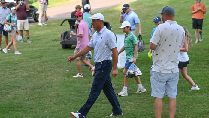 Bryson DeChambeau is lucky after the fan picks up his ball
