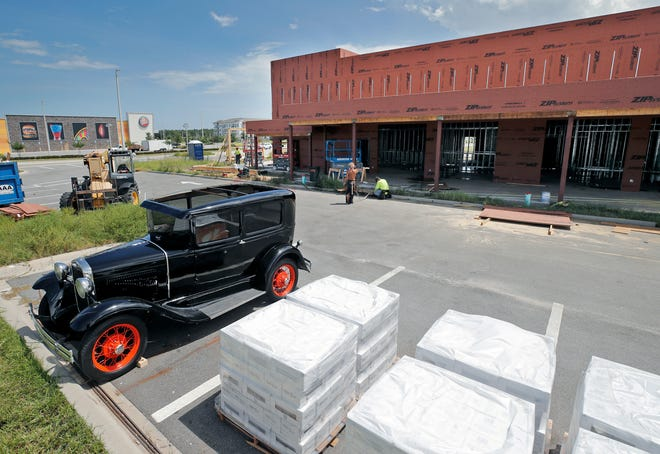 A Ford Model T is parked in front of the future antique car-themed Ford's Garage restaurant under construction at Tomoka Town Center shopping center in Daytona Beach on Tuesday, Sept. 7, 2021. The LPGA Boulevard corridor continues to see red-hot growth.