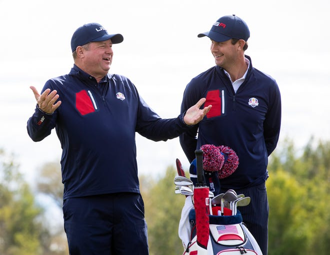Team USA caddy Eric Larson, left, takes a picture with Harris English during the official 43rd Ryder Cup portraits in Whistling Straits.