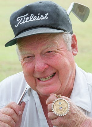Billy Maxwell shows off the medal he earned for winning the 1951 US Amateur.  The PGA Tour winner and longtime golf club owner in Jacksonville has died at the age of 92.